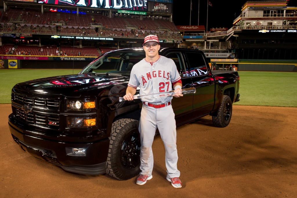 2015 MLB All-Star Game Most Valuable Player Mike Trout of the Los Angeles Angels of Anaheim poses with the MVP trophy and a Chevrolet Silverado Midnight Edition, the prize for his MVP win, Tuesday, July 14, 2015 at the Great American Ball Park in Cincinnati, Ohio. This is the second year in a row Trout won the award. Last year, he chose a Corvette Stingray. (Photo by LG Patterson/MLB Photos via Getty Images)