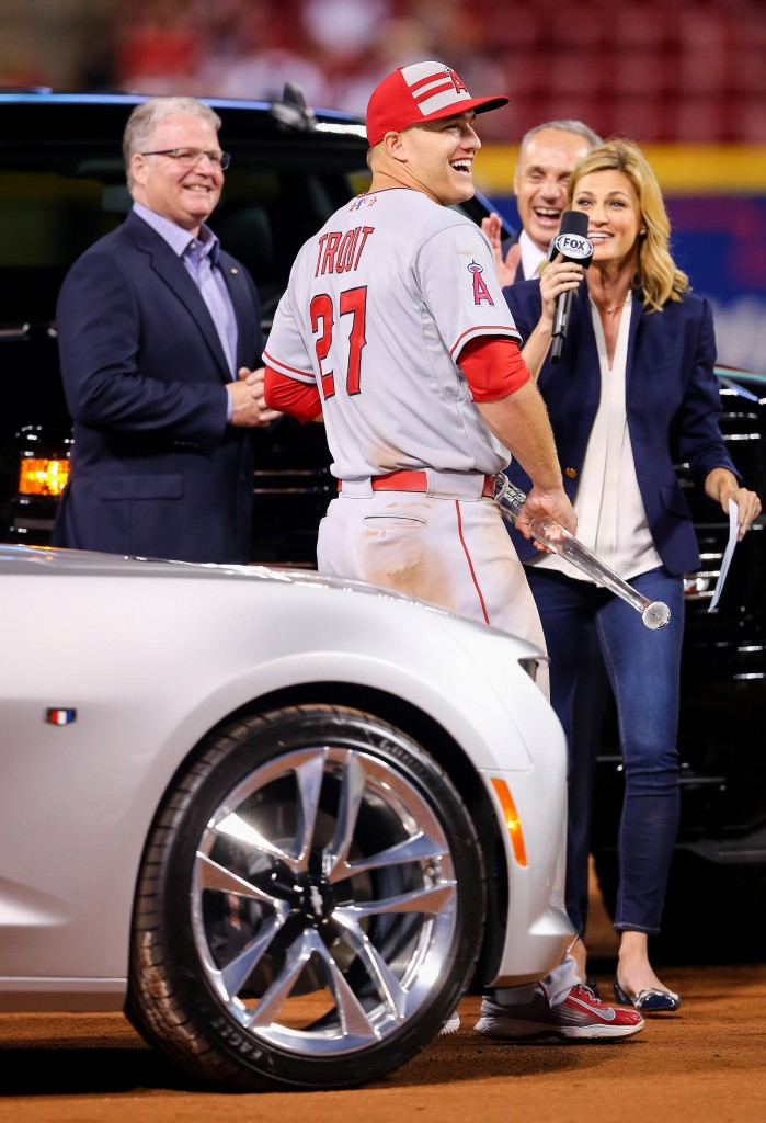 Chevrolet U.S. Vice President Brian Sweeney (left) presents 2015 MLB All-Star Game Most Valuable Player Mike Trout of the Los Angeles Angels of Anaheim with a Chevrolet Silverado Midnight Edition, the prize for his MVP win, Tuesday, July 14, 2015 at the Great American Ball Park in Cincinnati, Ohio. Trout was given a choice between the Silverado and a Camaro Convertible. This is the second year in a row Trout won the award. Last year, he chose a Corvette Stingray. (Photo by Elsa/Getty Images)